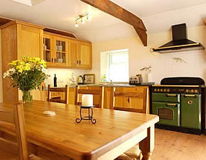 Fitted kitchen with solid beech units, superb range type cooker and dining table for eight